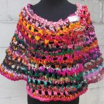 Free Knitting Pattern for an Openwork Capelet in Vibrant Jewel Tones for a Casual Look