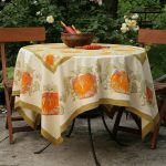 Add a Pumpkin Tablecloth to a Table for Fall Parties and Decorating